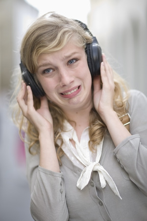 Young woman hearing music