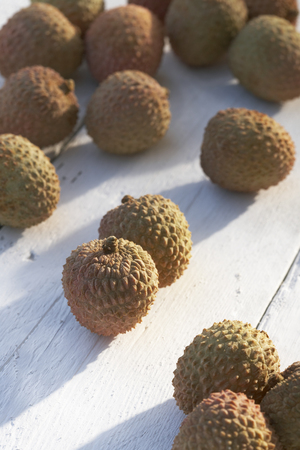 conforms: Collection of lychees on sunny table