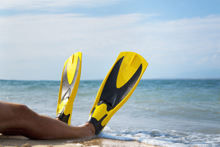 saturating: Man with flippers at the beach
