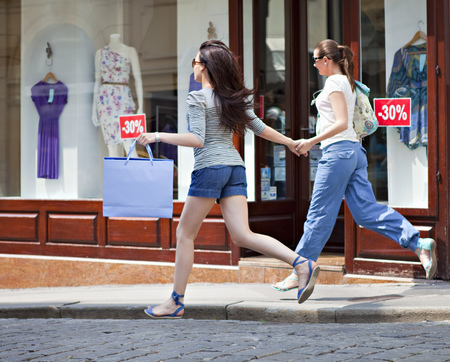 2 way: Young women running along street