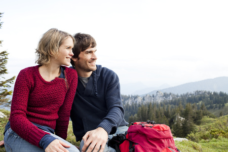 ceased: Couple watching landscape on mountain