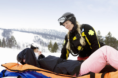 Woman Rescuer with Skier LANG_EVOIMAGES