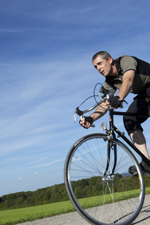 Man cycling with road bike