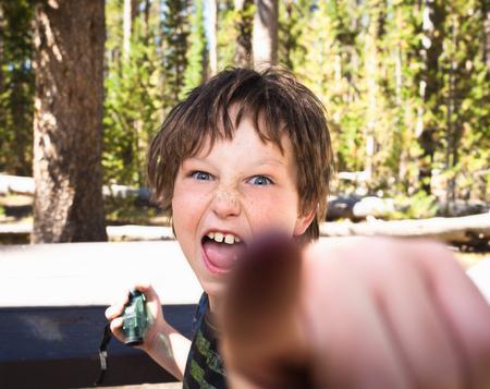 rudeness: Boy confronting camera