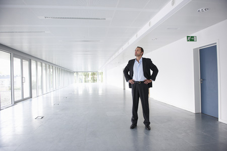 new age: Businessman in an empty office LANG_EVOIMAGES