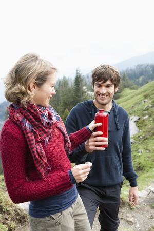 ceased: Man offering woman bottle