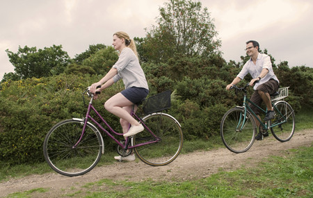 pursued: Couple bicycle over heath