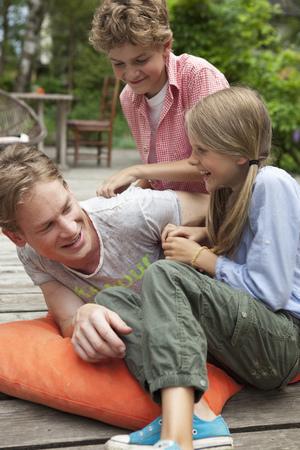 Sibling teasing their older brother LANG_EVOIMAGES