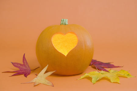 customs and celebrations: Pumpkin with heart-shape lit from inside