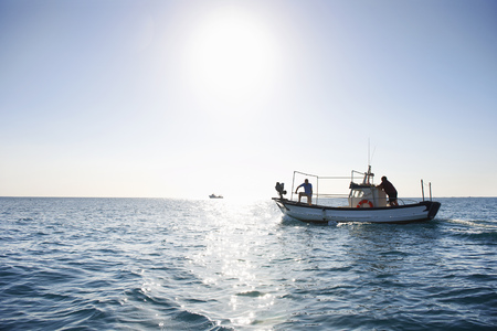 Fishermen on fishing boat at sea LANG_EVOIMAGES