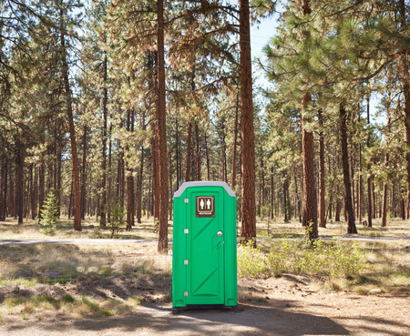 grooming: Portable toilet on edge of forest