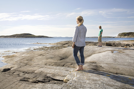 dubious: Man and woman looking out to sea