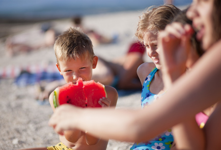 morsels: Kids eating watermelon at the beach