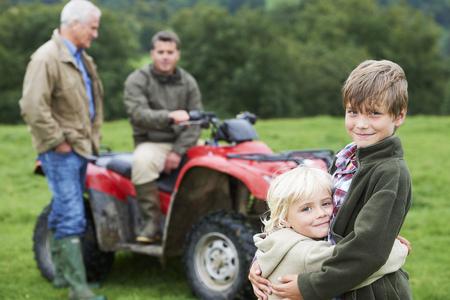 transportation: Family on quad bike