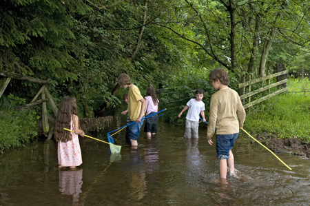 Kids fishing in the river LANG_EVOIMAGES