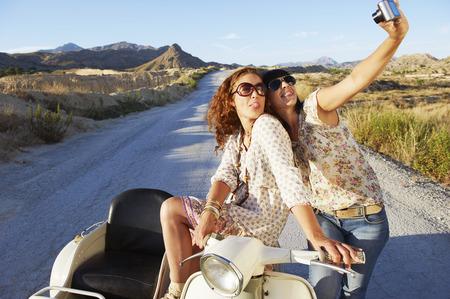 Women on motorbike taking photos