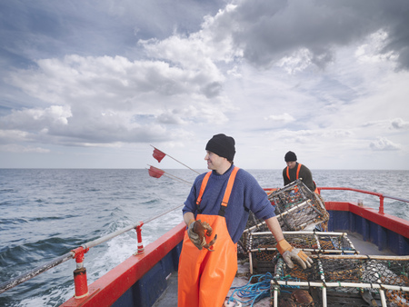 Fishermen with crab and lobster pots LANG_EVOIMAGES