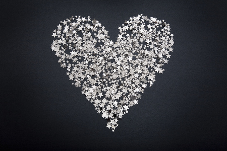 Heart shape figure made of small stars LANG_EVOIMAGES