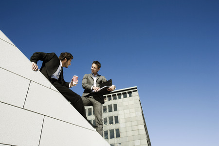 highrises: Men doing business on roof