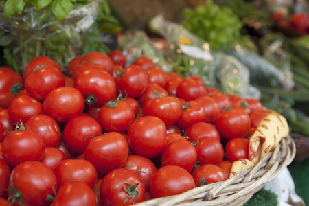 flogging: A basket full of tomatoes on a market