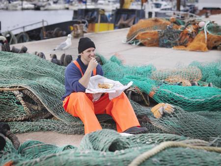 Fisherman eating fish and chips