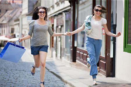 rushed: Young women running along street