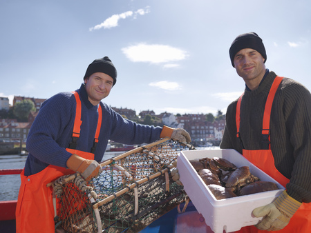 lobster boat: Fishermen with crabs and lobster pots