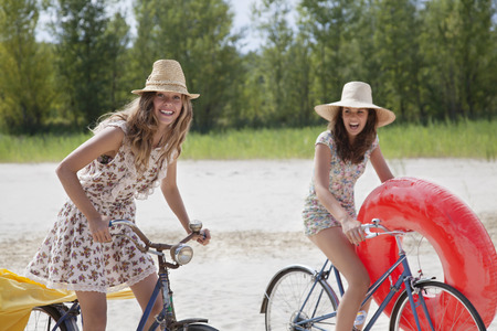 whimsy: Two pretty women cycling on the beach