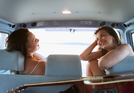 musically: Women camping in back of car