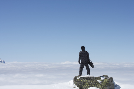 snows: Snowboarder overlooking mountainside