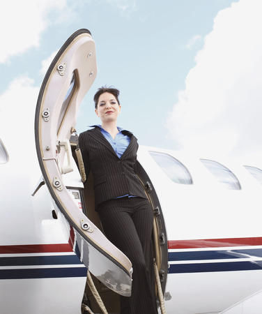 welldressed: Business woman stepping of corporate jet