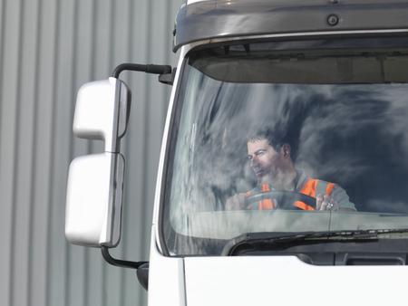 18 wheeler: Driver looking in truck mirror