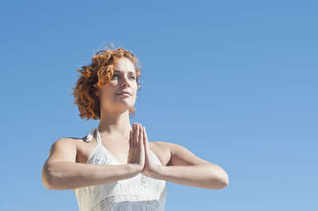 pleaded: Young woman performing yoga LANG_EVOIMAGES