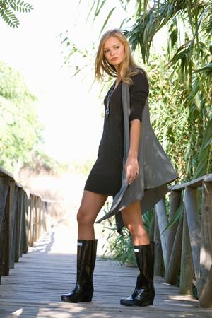 Beautiful girl walking on boardwalk