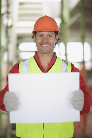 enthusiastically: Worker holding an empty sheet of paper