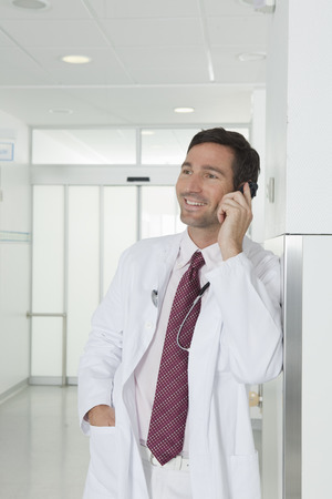 passageways: Doctor on the phone in hall