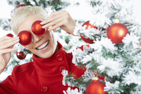 obscuring: Womans eyes behind christmas decoration