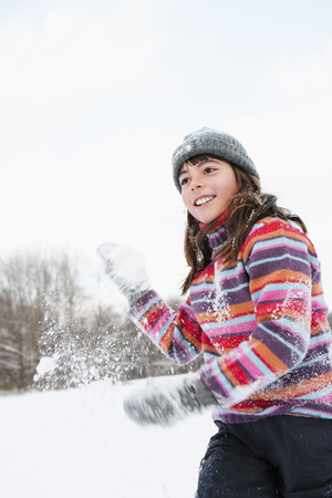 tosses: Girl throwing a hand full of snow