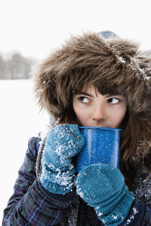 snows: Girl sipping hot drink