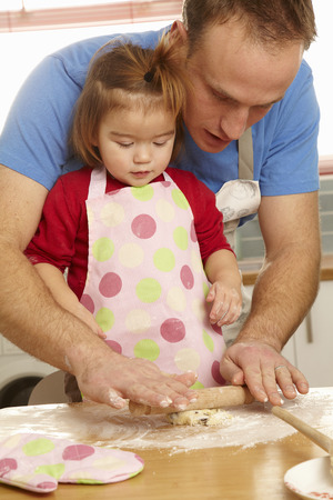poppa: Father and daughter cooking together