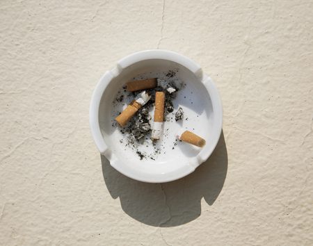 Astray with cigarette stubs LANG_EVOIMAGES
