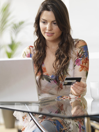require: Woman at home shopping online