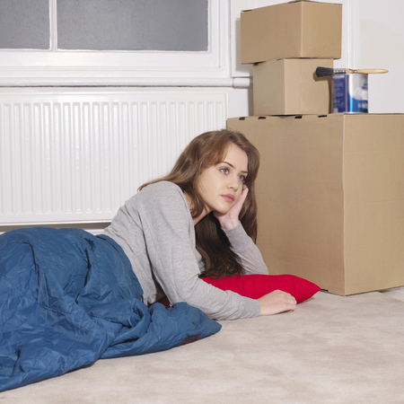 musing: Young woman next to boxed awake