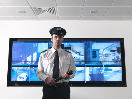 safeguarded: Security guard in control room