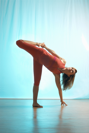 Lady doing yoga in a studio