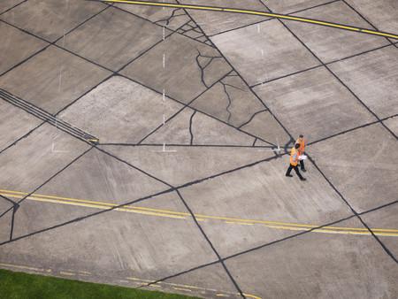 high flown: Engineers on aircraft runway