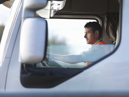 18 wheeler: Truck driver in truck cab LANG_EVOIMAGES