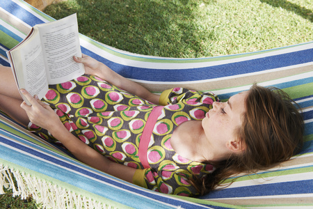 studied: Girl reading a book in a hammock
