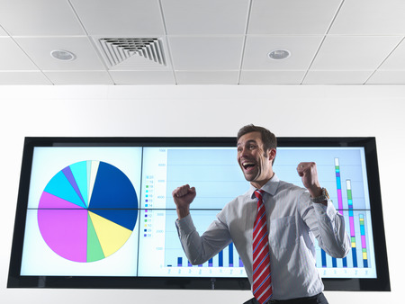 accomplishes: Successful businessman with graph
