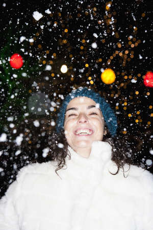 low spirited: Woman standing in snowfall LANG_EVOIMAGES